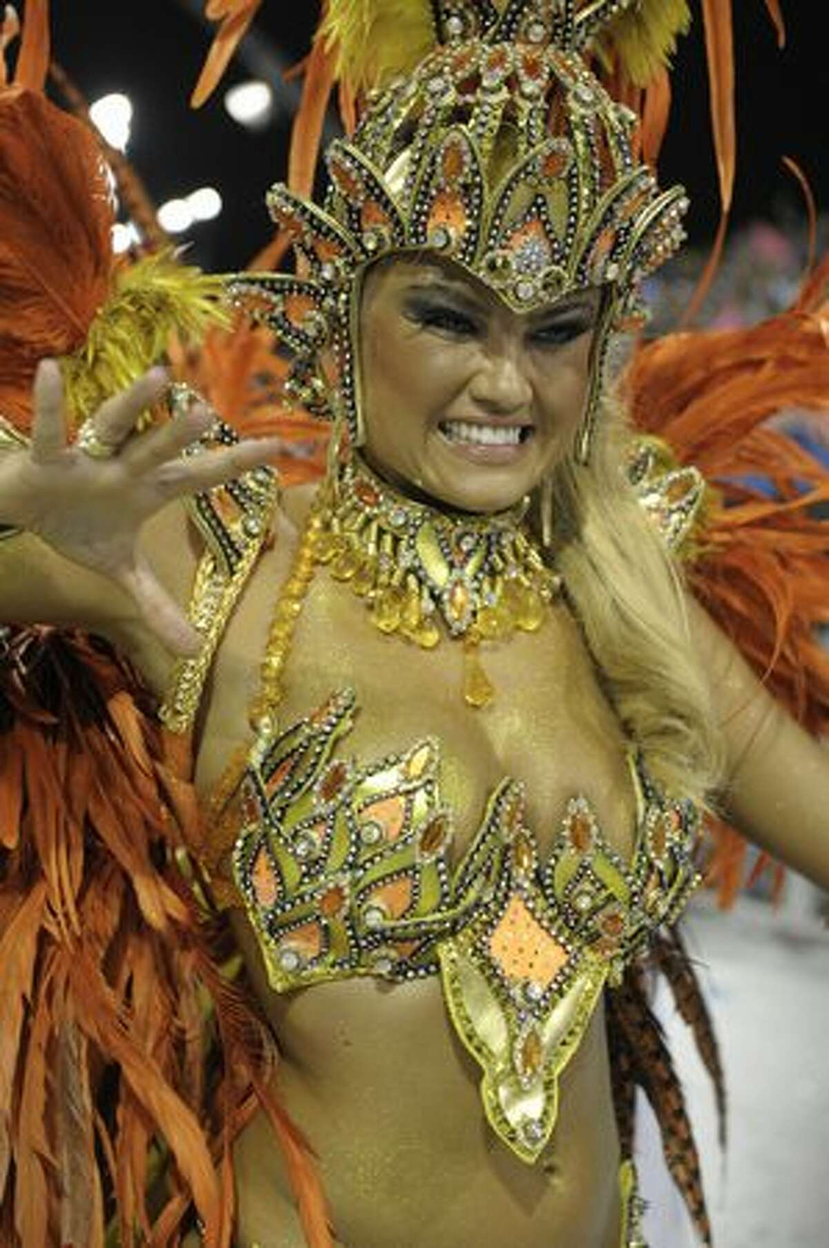 Brazilian model Ellen Roche, queen of the drummers of Rosas de Ouro samba school, dances during the opening night of parades at the Sambadrome, as part of Carnival celebrations in Sao Paulo, Brazil, early on Saturday, March 5, 2011. Brazil's Carnival kicked off with millions of people taking to the streets of the northeastern city of Salvador de Bahia to dance and party, effectively putting the nation on a week-long hiatus.