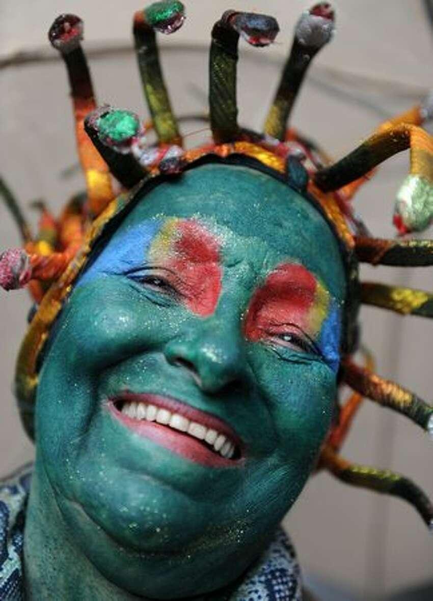 A reveller laughs during the traditional 'Cordao do Bola Preta' carnival band parade along Rio Branco avenue, in downtown Rio de Janeiro.