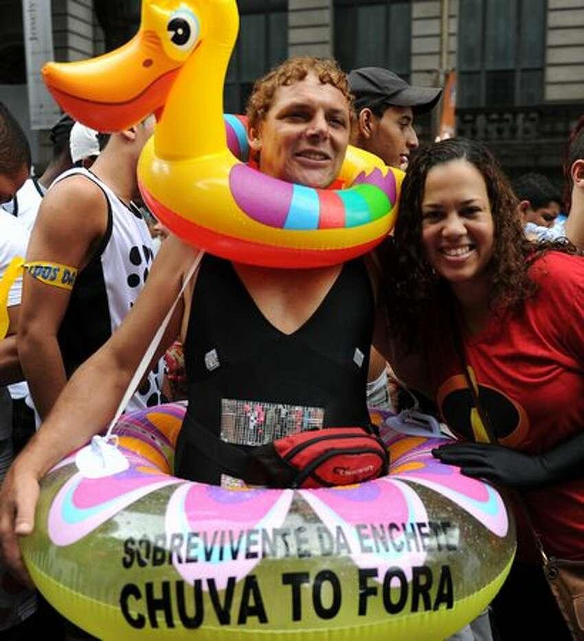 Revellers take part in the traditional 'Cordao do Bola Preta' carnival band parade along Rio Branco avenue, in downtown Rio de Janeiro.