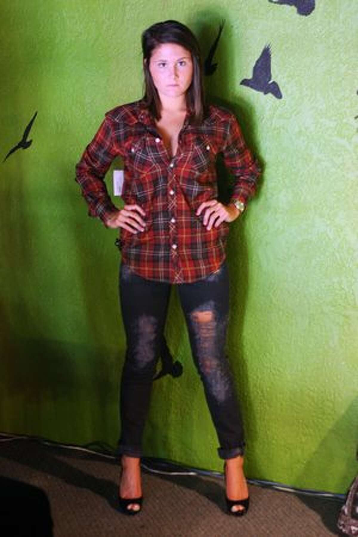 Alexus Sheft, sister of the owner Brittany Shefts, models a modern farmgirl look.