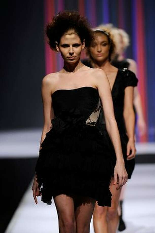 A model showcases a design by Aurelio Costarella on the catwalk during the StyleAid Perth Fashion Event 2010 at the Burswood Entertainment Complex in Perth, Australia. Photo: Getty Images