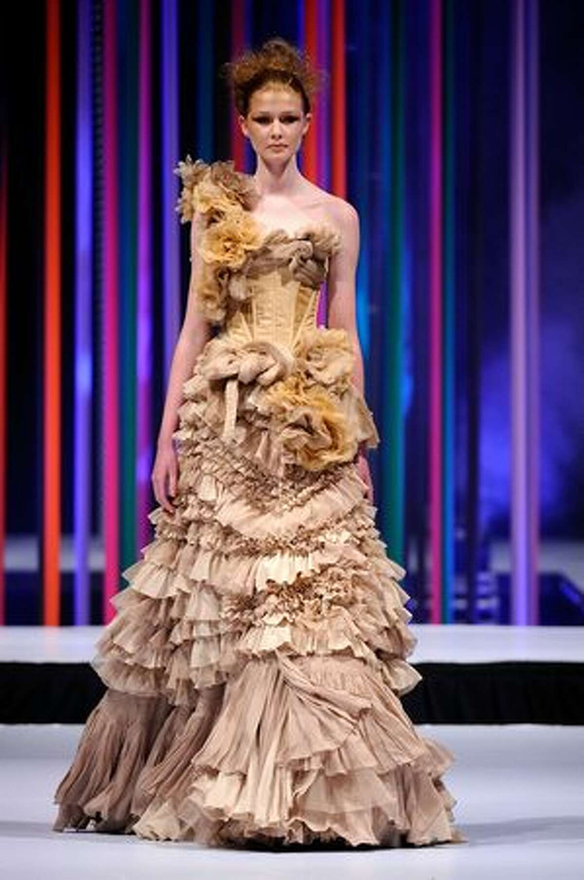 A model showcases a design by Aurelio Costarella on the catwalk during the StyleAid Perth Fashion Event 2010 at the Burswood Entertainment Complex in Perth, Australia.