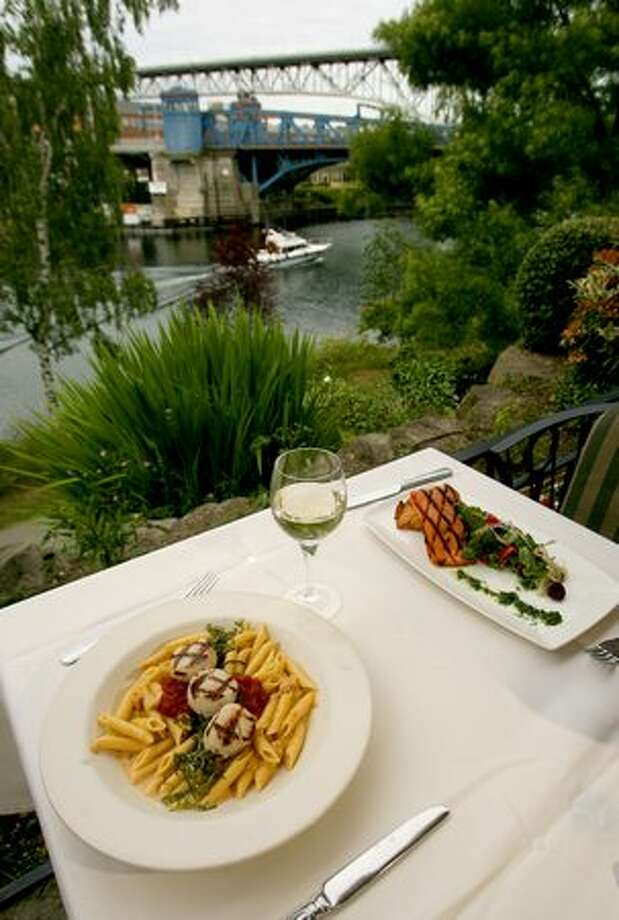 A view overlooking the Fremont Bridge with the Thai curry penne and grilled Copper River salmon at the Ponti Seafood Grill, June 2008. Photo: P-I File