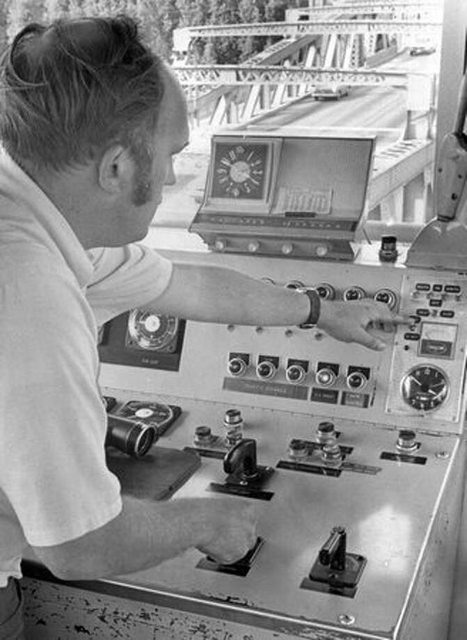 J. Olson at Fremont Bridge control board, August 15, 1972. Photo: P-I File