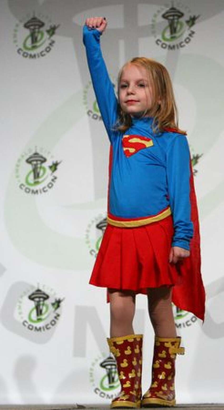 Macayla Reeves, 4, takes flight onstage during the Emerald City Comicon Masquerade costume competition.