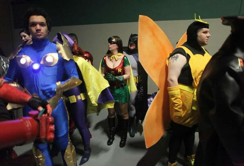 Participants gather backstage during the Emerald City Comicon Masquerade costume competition on Saturday, March 5, 2011.