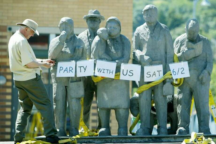 "Richard Beyer's much loved sculpture ""People Waiting for the Interurban"" returned to its island in the middle of North 34th Street in Fremont on Wednesday, May 30, 2007. The statue was moved in February 2006 and had a celebration for its return. Photo: P-I File"