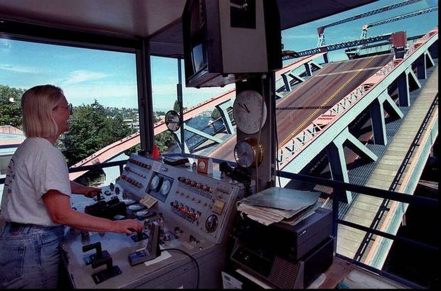 The 1995 photo caption read: Darlene Angedal operates the Fremont Bridge opening it for boats to pas