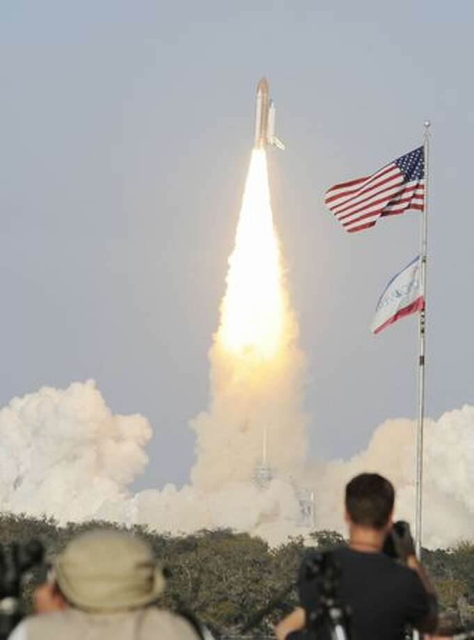 The space shuttle Discovery lifts off Feb. 24 from Kennedy Space Center in Florida on a mission to the International Space Station. It is the 39th and final flight for Discovery. Photo: Getty Images