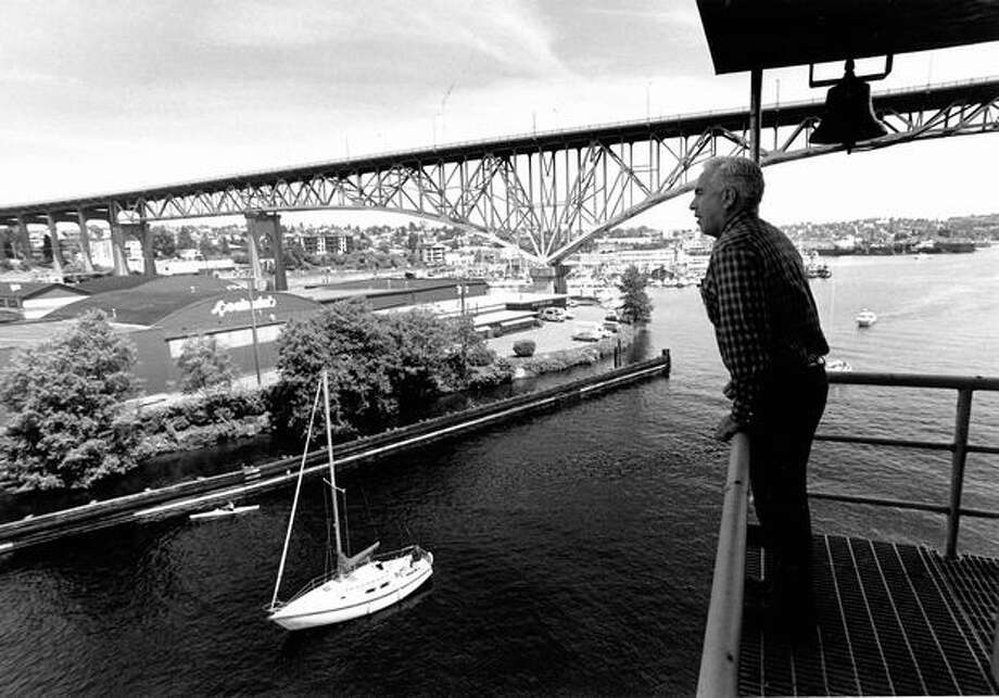 The June 1984 caption read: Bridge tender Ken Leask checks the status of approaching boats before opening the Fremont Bridge. Photo: P-I File