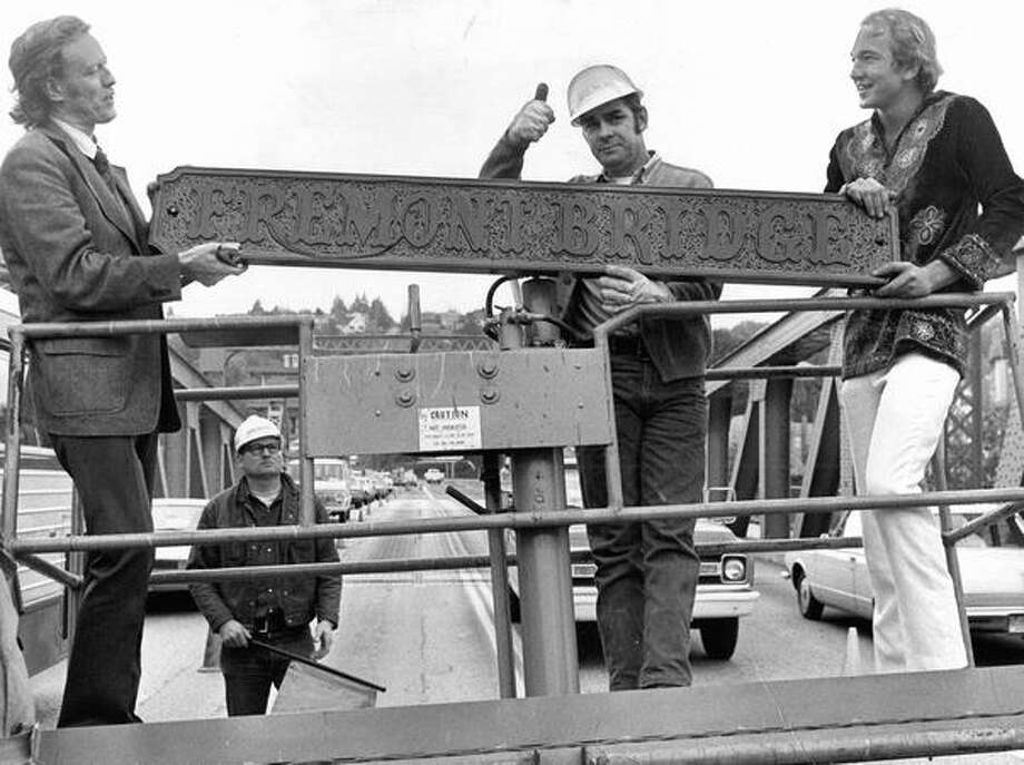 Roy Ruden of the City Engineering Department, center, signals to a truck driver, October 1973. Photo: P-I File