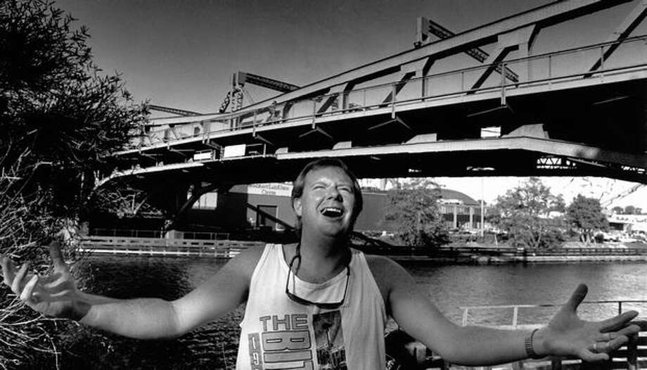 "The August 1991 photo caption read: Ed Devine has little patience for the bridge, ""It never fails, as soon as I get up to it, I hear the 'ding, ding, ding.'"" Photo: P-I File"