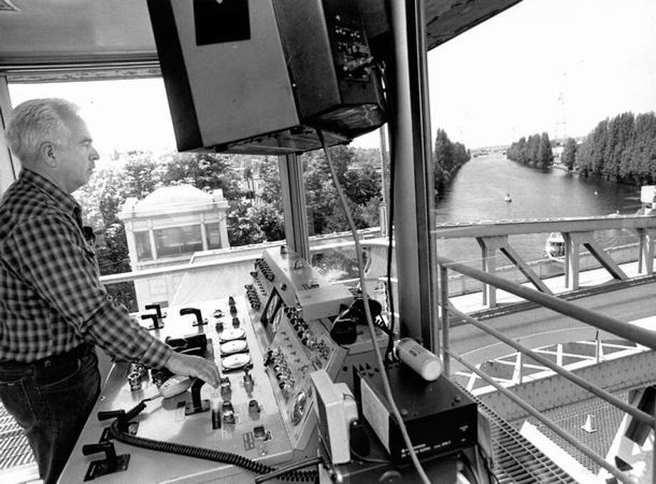 "The June 1984 caption read: Ken Leask, senior operator on the Fremont Bridge, says the span averages more than 1,000 openings a mongth for eight months a year and between 600 and 1,000 openings the other four months. ""In July 1978 we had 1, 799 openings,"" he said. Photo: P-I File"
