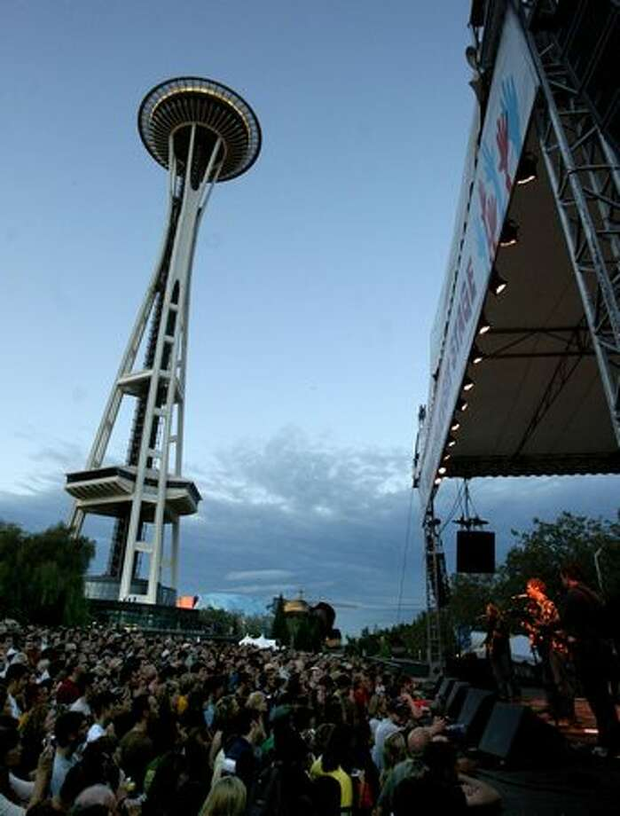 The Frames perform in the shadow of the Space Needle on the Sound Transit Stage at Bumbershoot 2007. Photo: P-I File