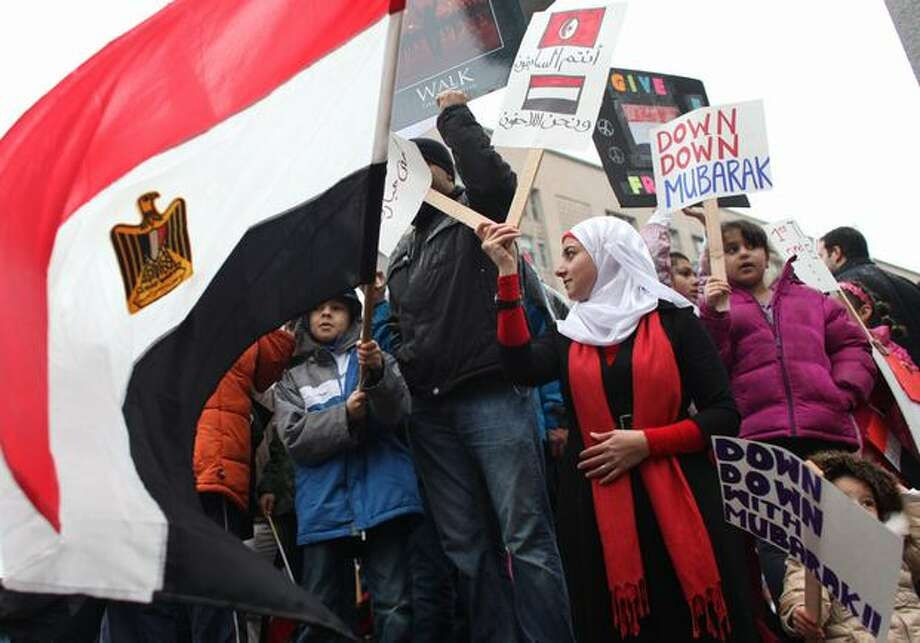 Protesters gather during a protest against Egyptian President Hosni Mubarak and his government on Saturday, Jan. 29, 2011 at Westlake Park in Seattle. Nearly 500 people gathered to show solidarity with protesters that have taken to the streets of Egypt. Photo: Joshua Trujillo, Seattlepi.com