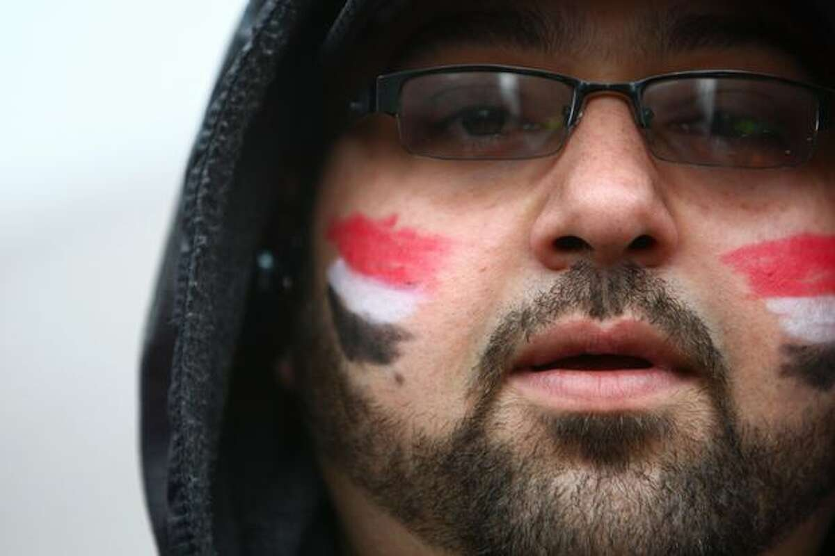 Mostafa Aly wears his national colors on his face during a protest against Egyptian President Hosni Mubarak and his government.