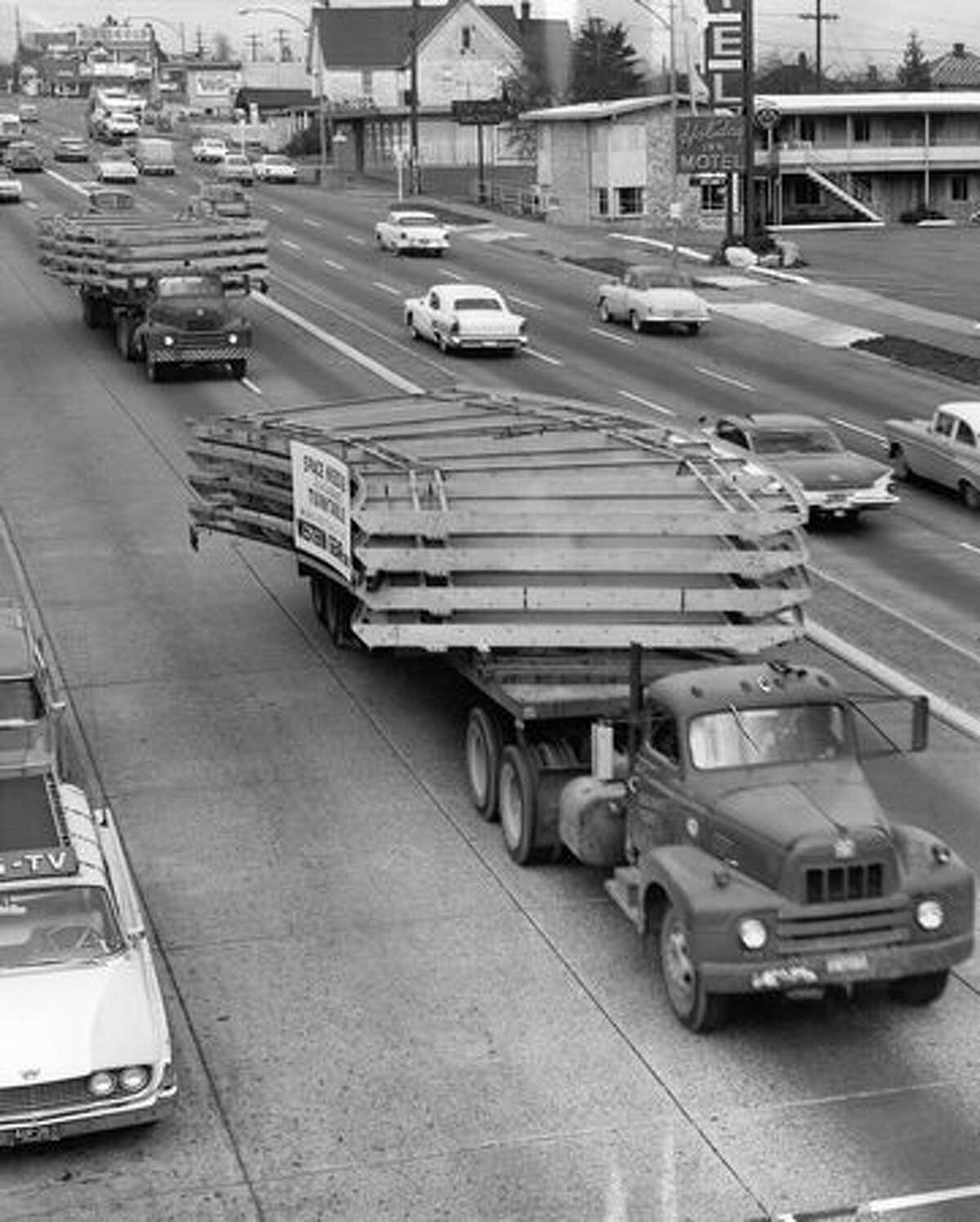 Parts of the Space Needle are driven down Aurora Avenue North, Nov. 17, 1961.