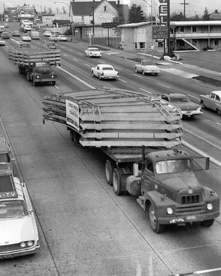 Parts of the Space Needle are driven down Aurora Avenue North, Nov. 17, 1961. Photo: P-I File