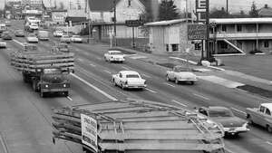 Parts of the Space Needle are driven down Aurora Avenue North, Nov. 17, 1961.