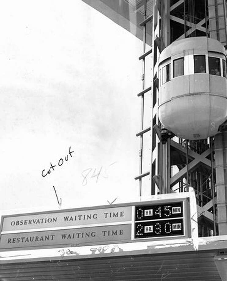 A sign at the Space Needle showing the time. Exact date unknown. Photo: P-I File