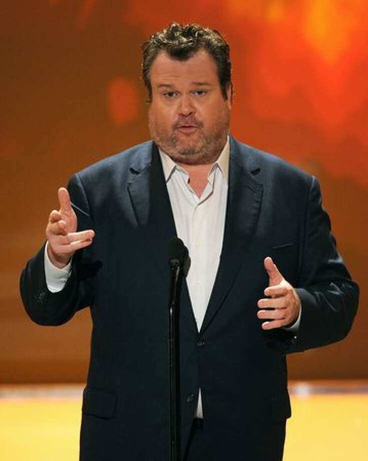Actor Eric Stonestreet speaks onstage. Photo: Getty Images