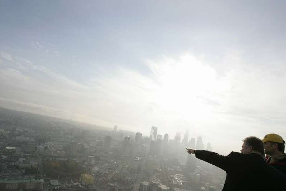 Seattle Mayor Greg Nickels points toward downtown Seattle while atop the Space Needle in Seattle on Wednesday, October 31, 2007. (Staff Photo/Seattle Post-Intelligencer/Mike Kane) Photo: P-I File