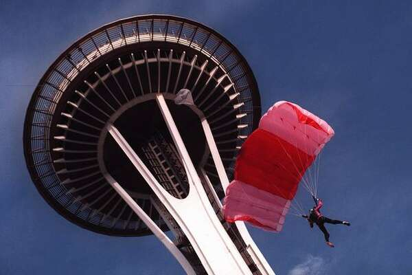 Jessica Kluetmeier parachutes from the Space Needle, November 1997. She was taken to Harborview Medical Center after the jump didn't go as expected, but recovered.