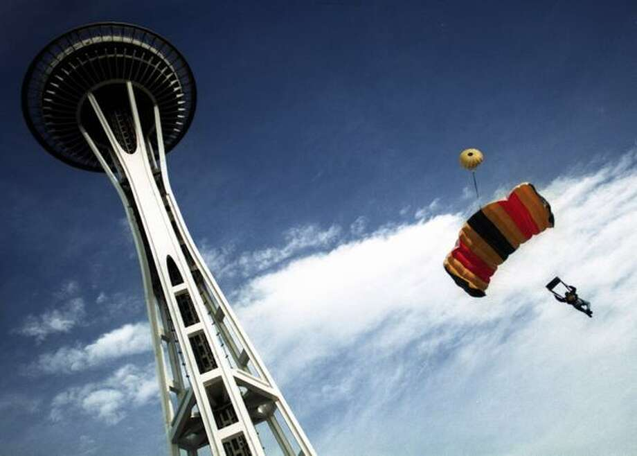 A parachuter jumps off the Space Needle in a first group of jumpers that leaped in November 1997. Photo: P-I File