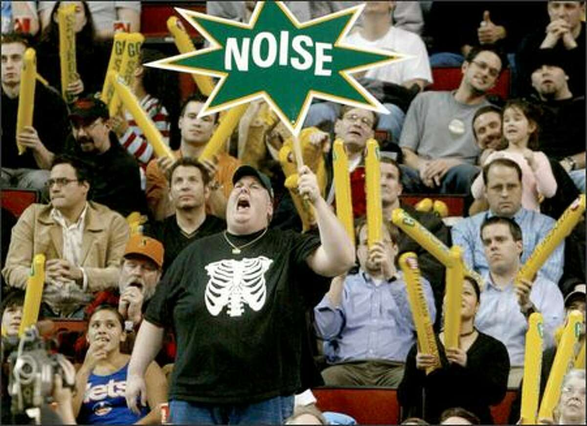 Sonics fans erupt in the final seconds of the loss to the Dallas Maverics at KeyArena.