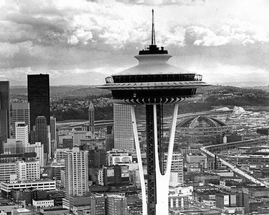 The Space Needle, March 1975, with the Kingdome under construction in the background. Photo: P-I File
