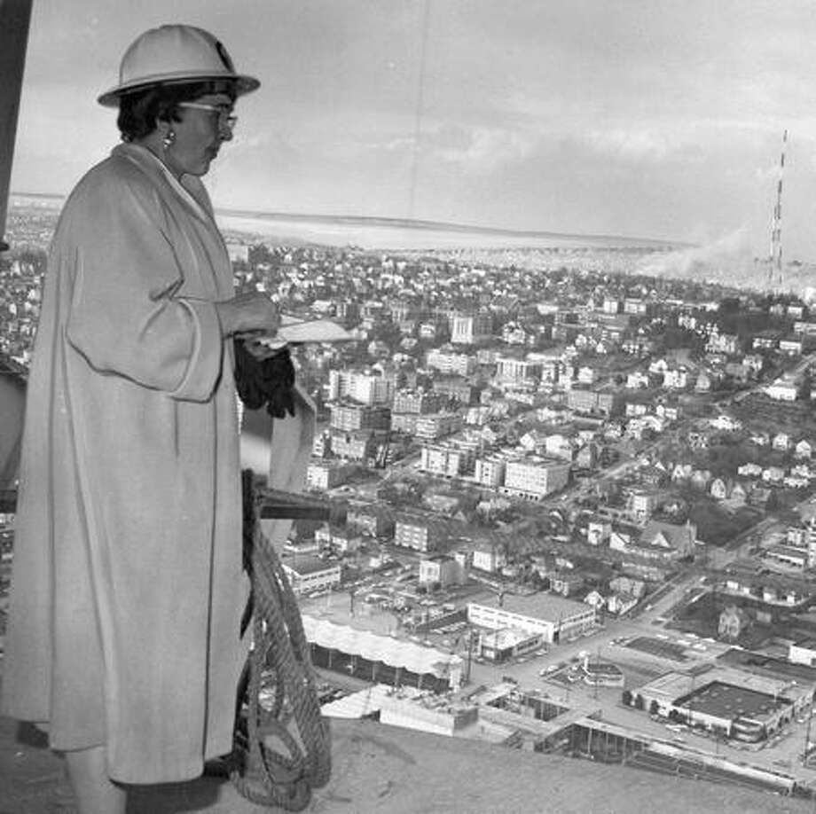 The caption for this Dec. 2, 1961 photo announced Eleanor Bell as the first woman to reach the top of the Space Needle. Photo: P-I File