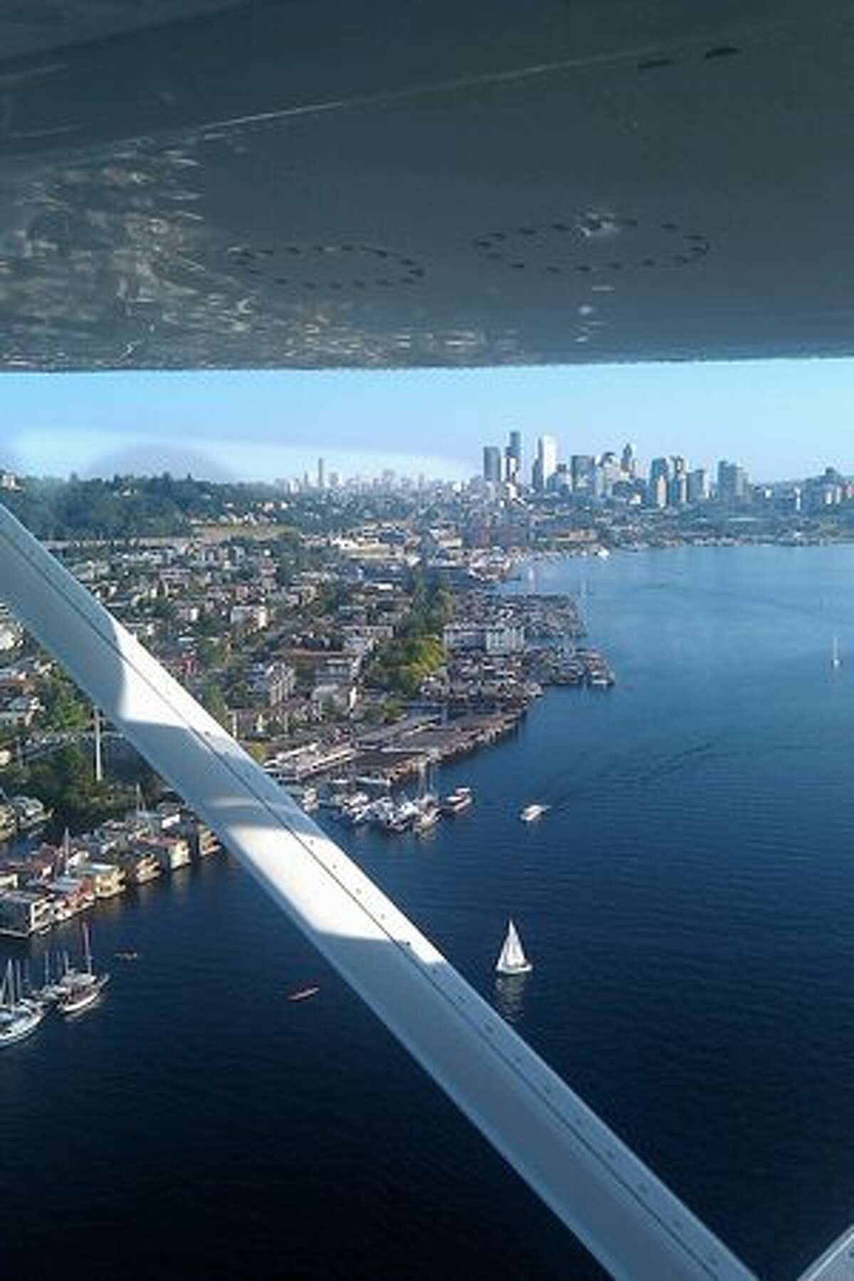 A view of Lake Union and downtown Seattle from a Kenmore Air de Havilland Beaver on the way from Ganges, B.C., to Lake Union, in Seattle, Wa.