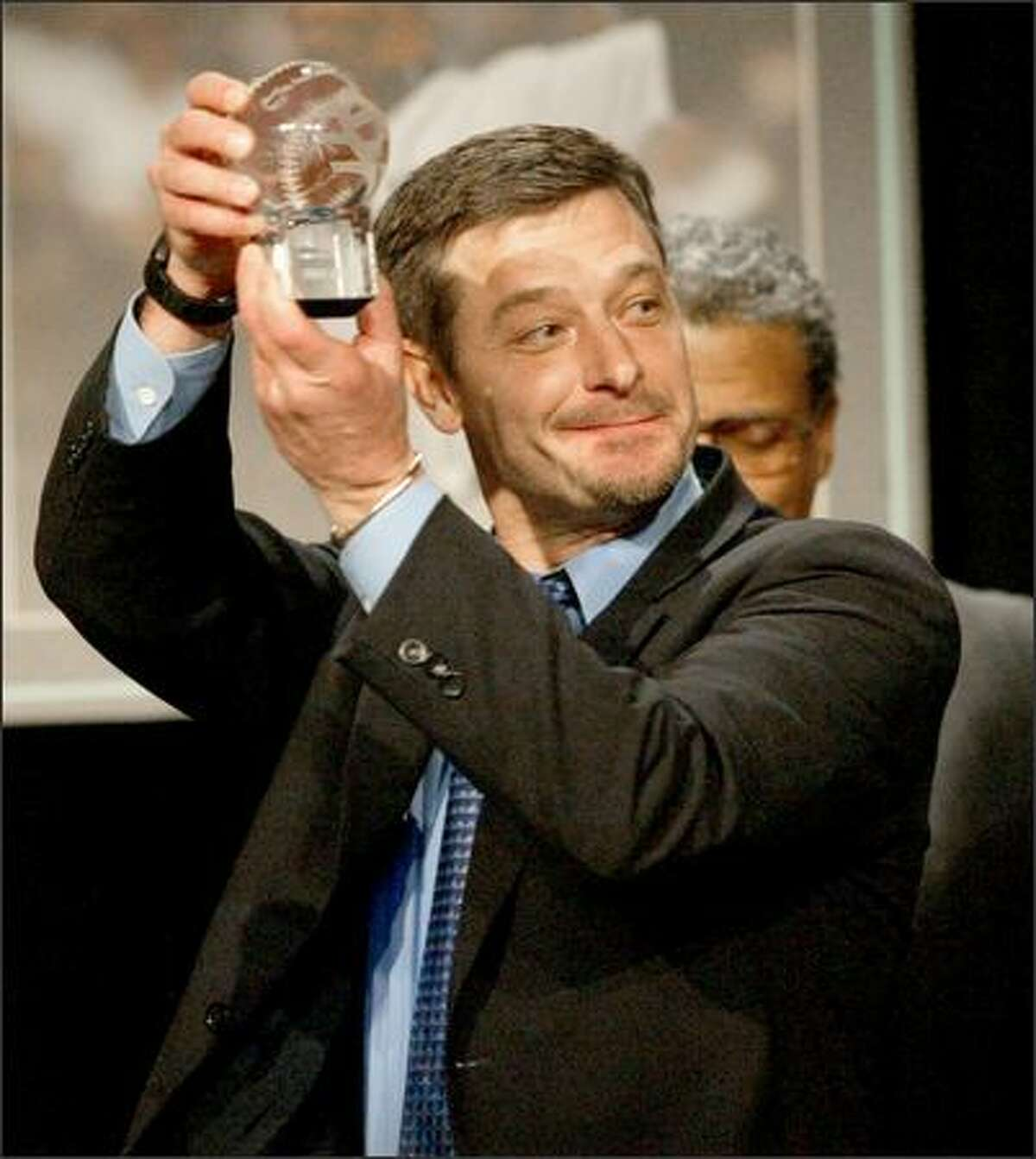 Jamie Moyer displays the Hutch Award.