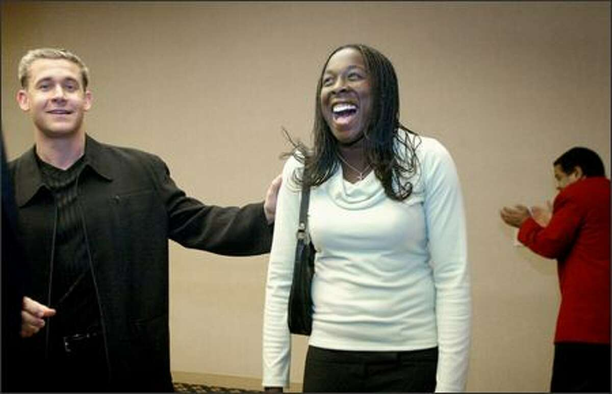 Mariners second baseman Bret Boone jokes with University of Washington soccer player Tina Frimpong before last night's P-I Sports Star of the Year banquet.