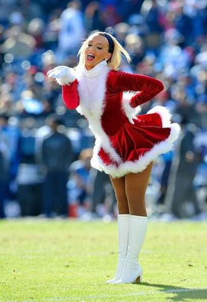 A Tennessee Titans cheerleader performs just before Christmas.