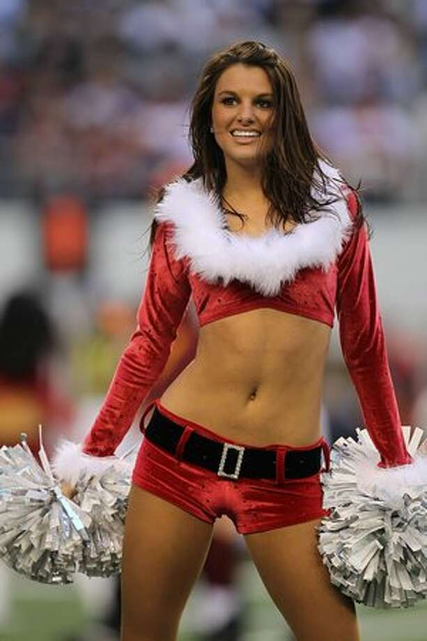 A Dallas Cowboys cheerleader performs just before Christmas. Photo: Getty Images