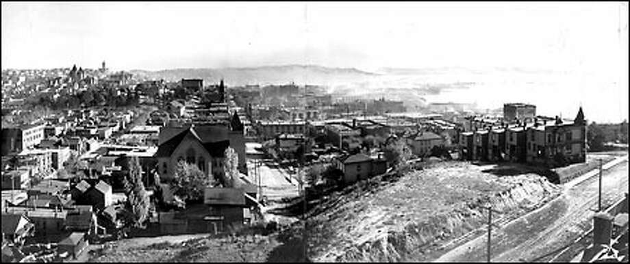 Looking south from Denny Hill, 1903: After the Seattle fire of 1889 that destroyed much of downtown, the economic boost brought by the Alaska Gold Rush helped the city quickly rebuild. The surrounding neighborhoods also grew quickly, and Seattle reached a population of 80,671 in 1900. This view of the city was made in 1903 from the edge of Denny Hill. The intersection in the foreground is Third Ave. and Pine Street. Photo: Seattle Post-Intelligencer