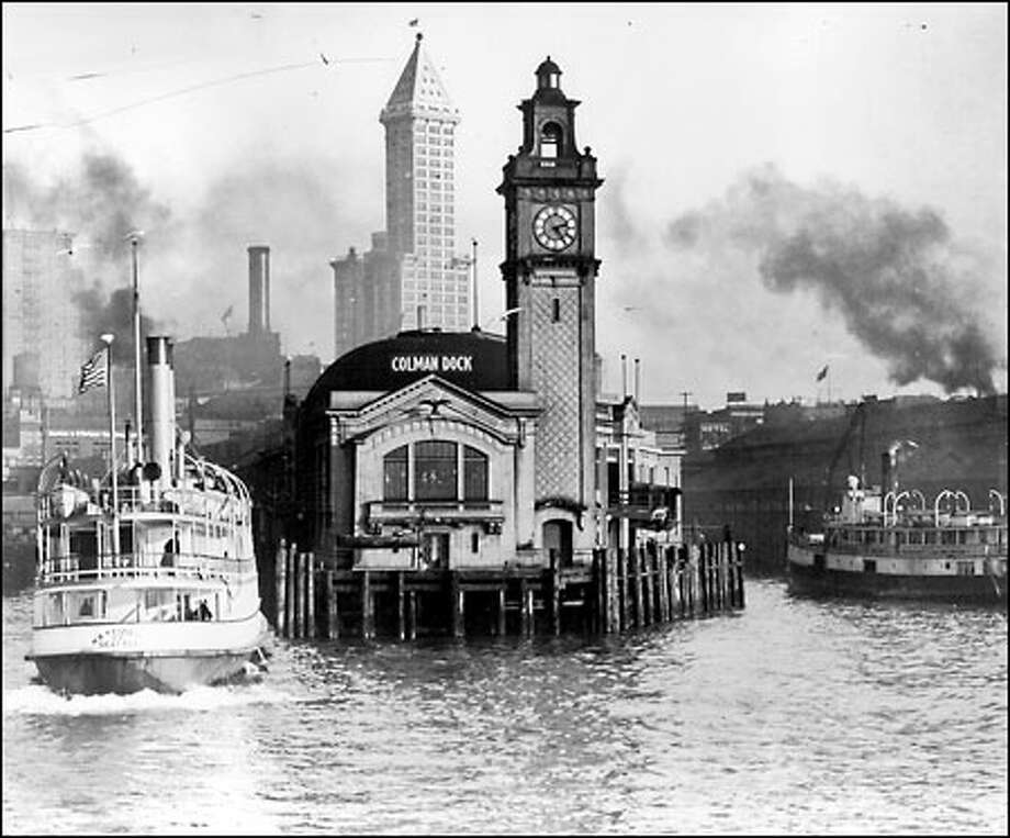 Colman Dock, 1916: Colman Dock was built by James Colman in 1882. It became the terminal for the Mosquito Fleet, the small steamers shown here that once were Puget Sound's major transportation link. The dock burned in the Seattle fire of 1889 but was soon rebuilt and turned into a thriving departure point for travelers headed for the Alaska gold rush. Photo: Seattle Post-Intelligencer