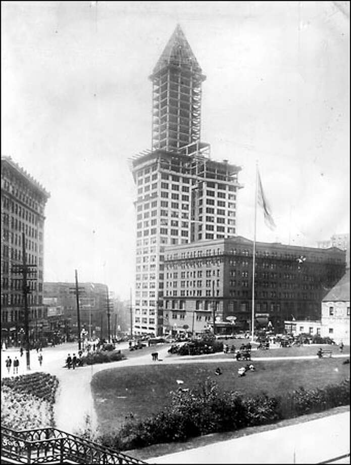 The Smith Tower under construction, 1912: In 1910, typewriter tycoon L.C. Smith surprised the city when he announced his plans to build a $1.5 million office building on the corner of Second Avenue and Yesler Way. When it was completed in 1914, the 42-story Smith Tower was the tallest building west of New York. The Smith Tower is shown under construction in 1912 from the east looking across City Hall Park. Photo: Seattle Post-Intelligencer