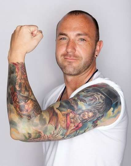 Lyman hoover shows his zombie sleeve the zombie themed for Seattle sounders tattoo