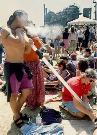 Dave Newton, left, and Tim O'brien, left, Seattle, take a smoke break during the 4th Annual Seattle Hempfest in 1994. (Photo by Jim Davidson)