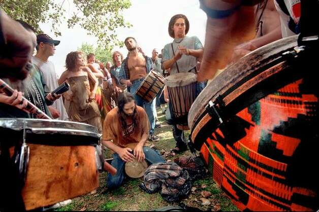 A circle of drums give plenty of beat for dancers at the Hemp festival at Myrtle Edwards Park in 1997. Photo: Grant M. Haller, Seattle Post-Intelligencer
