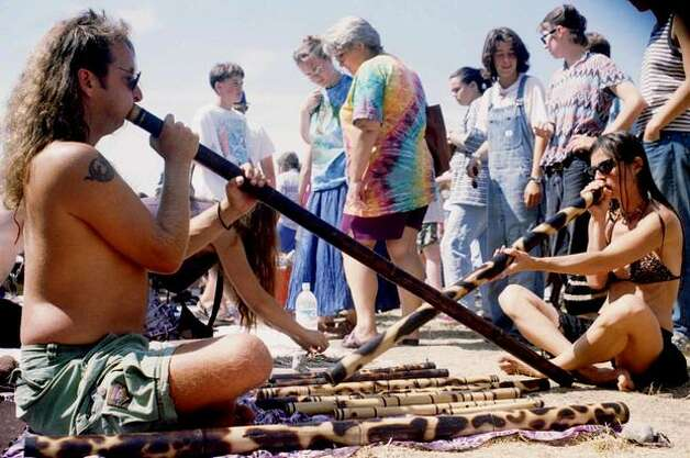 Mark Renner, left, and Patrice Sunshine, right, play the Didjeridu, an instrument native to Australia, at the 4th Annual Seattle Hempfest at Gasworks Park in 1994. (Photo by Jim Davidson)
