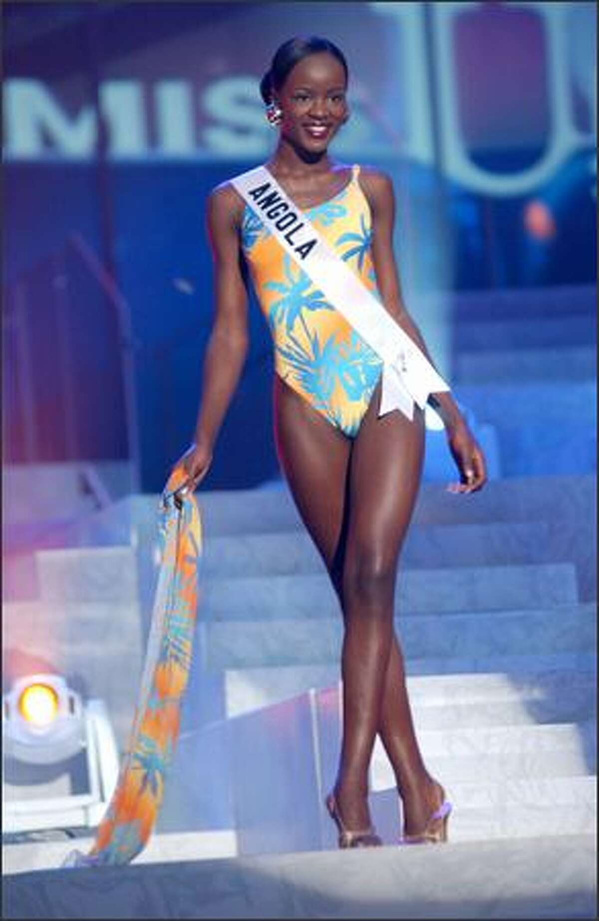 Telma de Jesus Esperanca Sonhi, Miss Angola, competes in her Endless Sun swimsuit during the 2004 Miss Universe Presentation Show on May 27 at CEMEXPO in Quito, Ecuador. Each delegate is judged by a preliminary panel of distinguished judges in three categories consisting of individual interview, swimsuit competition and evening gown competition. The scores will be tallied and the top 15 delegates will be announced during the NBC broadcast of the 53rd annual Miss Universe competition on June 1 at 9 p.m. (delayed PT).