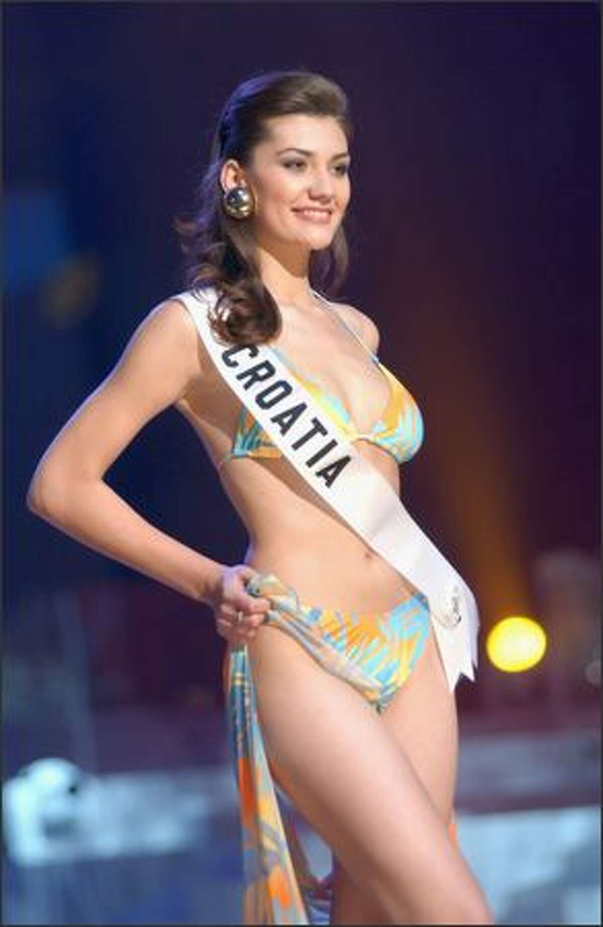 Marijana Rupcic, Miss Croatia, competes in her Endless Sun swimsuit during the 2004 Miss Universe Presentation Show on May 27 at CEMEXPO in Quito, Ecuador. Each delegate is judged by a preliminary panel of distinguished judges in three categories consisting of individual interview, swimsuit competition and evening gown competition. The scores will be tallied and the top 15 delegates will be announced during the NBC broadcast of the 53rd annual Miss Universe competition on June 1 at 9 p.m. (delayed PT).