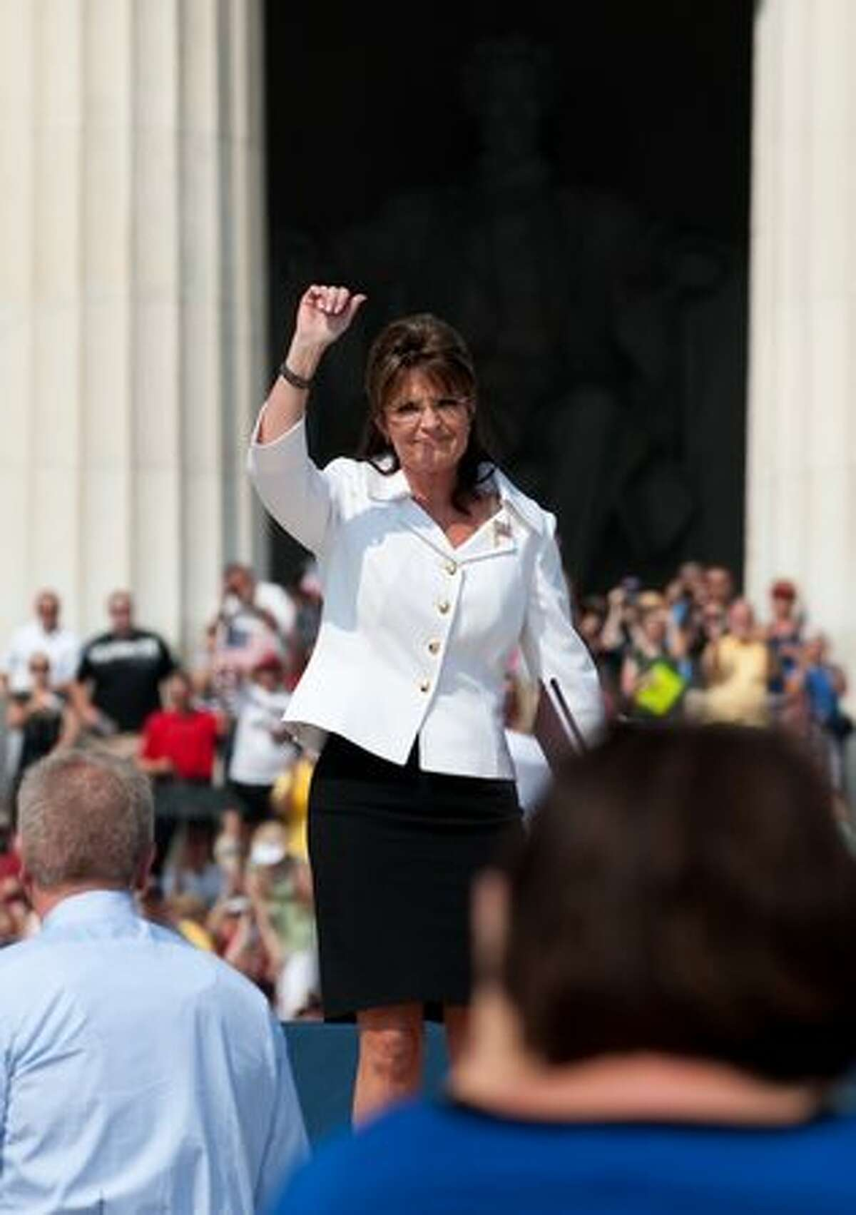 """Former Alaska governor Sarah Palin arrives to speak at a rally dubbed """"Restoring Honor,"""" to show support of the US military, organized by conservative US radio and television commentator Glenn Beck, one of the de facto leaders of the Tea Party movement at the Lincoln Memorial in Washington, DC, on August 28, 2010. The rally has attracted controversy because it is being held on the 47th anniversary of civil rights legend Martin Luther King Jr.'s """"I Have a Dream"""" speech, at the Lincoln Memorial on the National Mall, where King spoke. AFP PHOTO/Nicholas KAMM"""