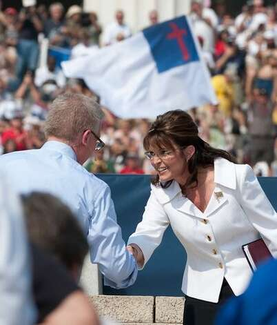 "Former Alaska governor Sarah Palin shakes hands with conservative US radio and television commentator Glenn Beck as she arrives to speak at a rally dubbed ""Restoring Honor,"" to show support of the US military, organized by Beck, one of the de facto leaders of the Tea Party movement, at the Lincoln Memorial in Washington on August 28, 2010. The rally takes place controversially at the spot where civil rights leader Martin Luther King made his legendary ""I Have a Dream"" speech 47 years ago AFP PHOTO/Nicholas KAMM Photo: Getty Images"