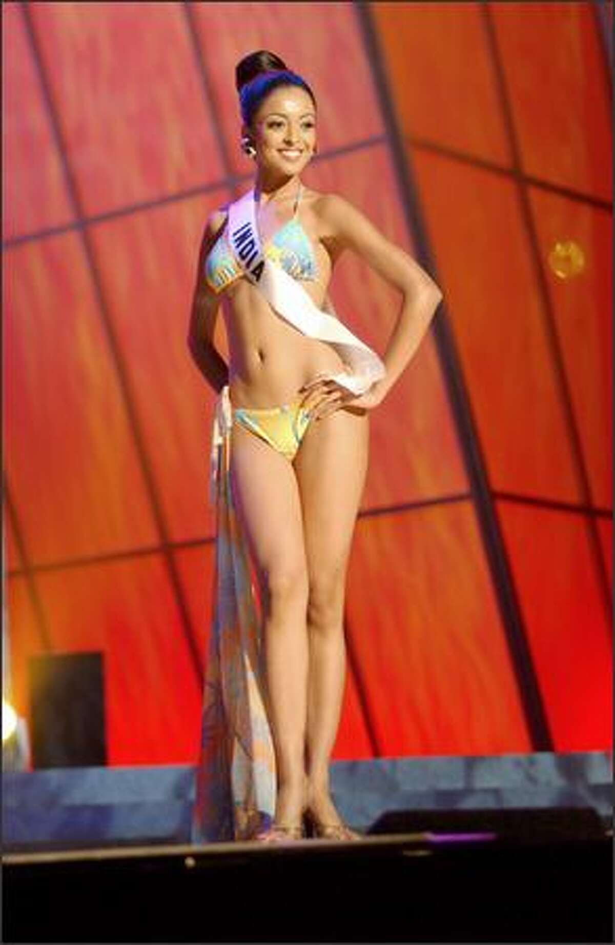 Tanushree Dutta, Miss India, competes in her Endless Sun swimsuit during the 2004 Miss Universe Presentation Show on May 27 at CEMEXPO in Quito, Ecuador. Each delegate is judged by a preliminary panel of distinguished judges in three categories consisting of individual interview, swimsuit competition and evening gown competition. The scores will be tallied and the top 15 delegates will be announced during the NBC broadcast of the 53rd annual Miss Universe competition on June 1 at 9 p.m. (delayed PT).