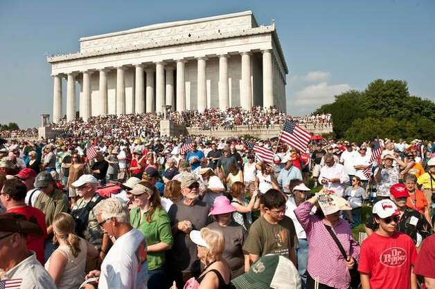 "People gather at a rally dubbed ""Restoring Honor,"" to show support of the US military, organized by conservative radio and television commentator Glenn Beck, one of the de facto leaders of the Tea Party movement, at the Lincoln Memorial in Washington, DC, on August 28, 2010. The rally has attracted controversy because it is being held on the 47th anniversary of civil rights legend Martin Luther King Jr.'s ""I Have a Dream"" speech, at the Lincoln Memorial on the National Mall, where King spoke. AFP PHOTO/Nicholas KAMM Photo: Getty Images"