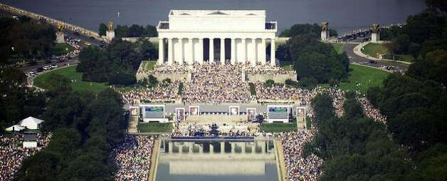 "People gather at the Lincoln Memorial on the National Mall on August 28, 2010, in Washington, DC. Thousands of Americans gathered Saturday in the heart of the US capital for a rally to ""Restore America,"" led by conservative icons including talk show host Glenn Beck and former Alaska governor Sarah Palin. AFP PHOTO/Jim WATSON Photo: Getty Images"